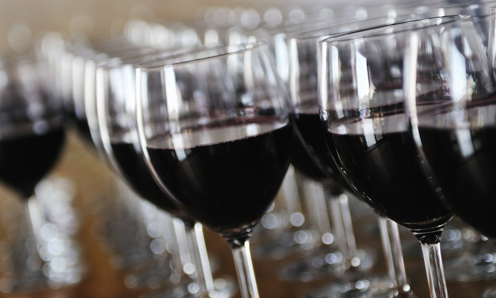 Glasses of red wine lined up
