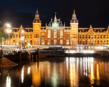 The Amsterdam Central Station is one of the places you can visit during a trip to Amsterdam, capital city of The Netherlands
