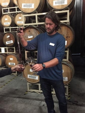 "Winemaker Greg Freeman ""thieves"" wine aging in barrel for lucky visitors. Photo by Barbara Barrielle"