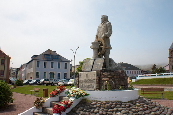Statue at center of town Saint-Pierre by Brian Summers