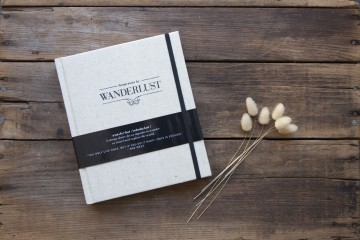 Wanderlust journal cover on wood