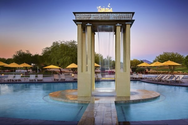 With the grand Wildfire water feature in the center acting as your beacon to the main pool complex, you can swim and enjoy views of Wildfire Golf Course's emerald fairways and Scottsdale's statuesque mountains. Photo by Werner Segarra courtesy of JW Marriott Phoenix Desert Ridge Resort & Spa