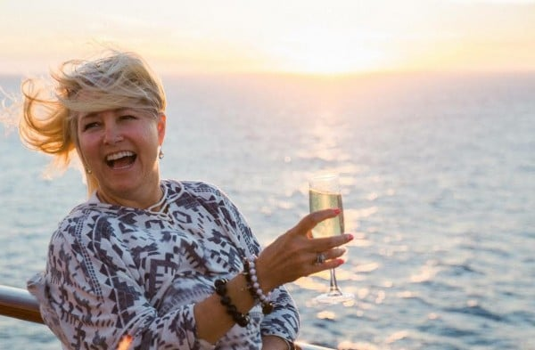 A glass of champagne at sunset crossing the Atlantic on the 2016 Nomad Cruise. photo credit: Barbara Barrielle