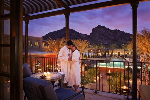 Couple relax on their balcony. Photo courtesy Omni Scottsdale Resort & Spa at Montelucia