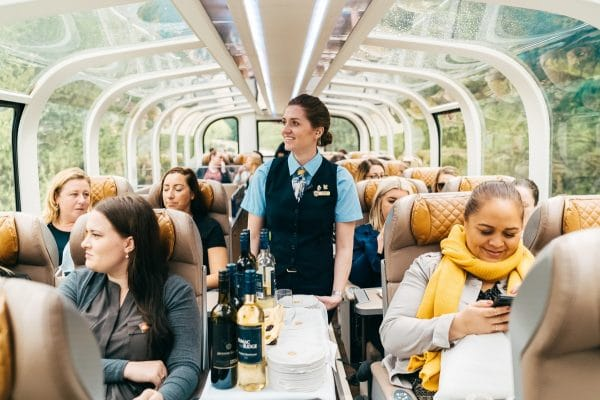 Throughout the season, hosts serve more than 4,000 cases of wine, helping create a jovial onboard atmosphere. Photo courtesy Rocky Mountaineer