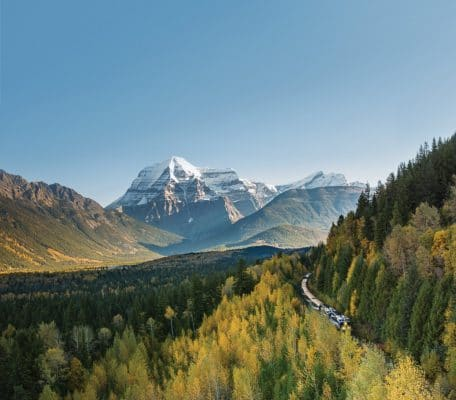 Rocky Mountaineer traveling past Mount Robson on Journey through the Clouds. Photo courtesy Rocky Mountaineer