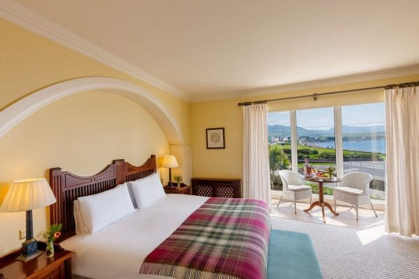 luxury hotels in County Kerry Guest room with a view of the Atlantic Ocean at the Butler Arms Hotel in Waterville, Ireland.