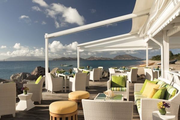 Beach front dining at Mango. Photo by Don Riddle courtesy Four Seasons Nevis