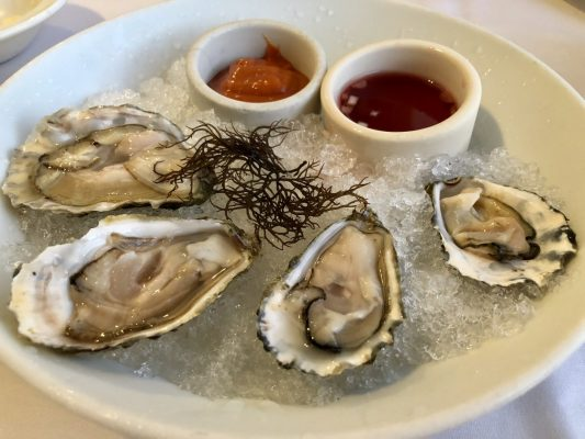 Enjoy fresh oysters at Merriman's Fish House. Photo by Jill Schildhouse