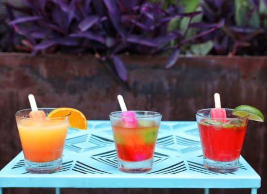 Enjoy a summer poptail at Lone Star Court in Austin. Left to right: Lone Star Sunrise, Sour Grapes, and Cherry Mint Freeze. Photo by Hayden Walker courtesy Valencia Hotel Group