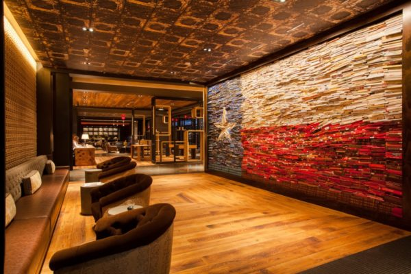 The Texas flag book wall in the lobby of The George in College Station. Photo courtesy Valencia Hotel Group.