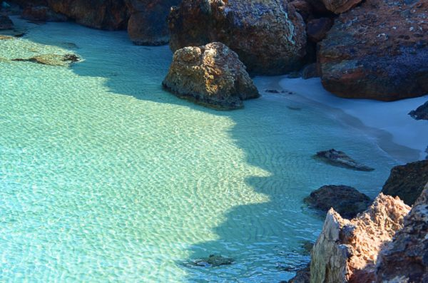 Enjoy the clear waters of Ibiza. Photo by wistaich via Pixabay.