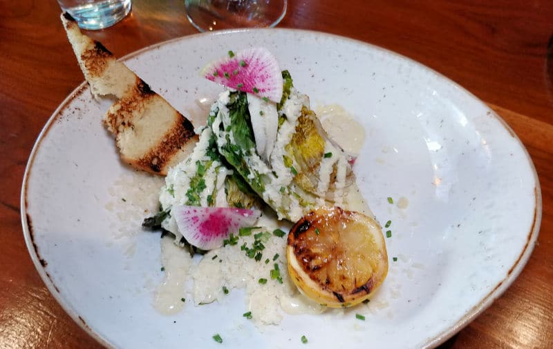 One of the restaurant's most unique dishes is a grilled Caesar salad. A must-order at Hotel Max in Seattle. Photo by Lara Dunning