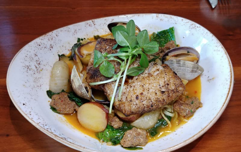 Along with a wide selection of grilled meat dishes, the Miller's Guild in Seattle also features grilled fish. Photo by Lara Dunning