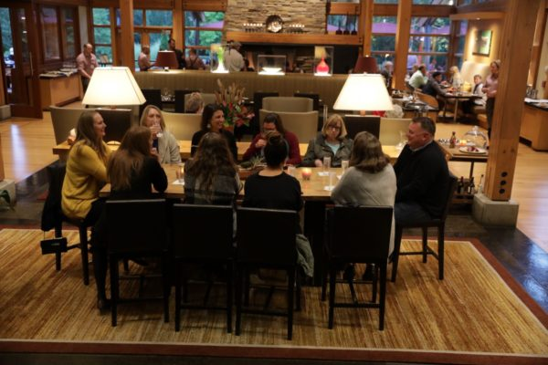 A group having dinner at the Copperleaf Restaurant.