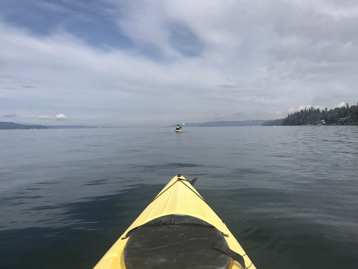 View of Puget Sound from the front of a yellow kayak south of Seattle