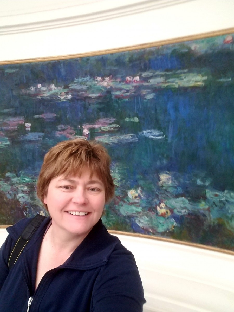 In front of Claude Monet's Water Lilies the Musee de l'Orangerie in Paris. Photo courtesy of Teresa Bitler.