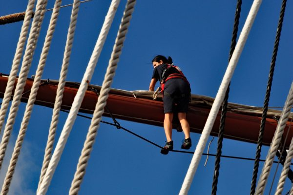 Deckhands climb Sea Cloud's masts and set her sails entirely by hand. Photo by Katherine Rodeghier