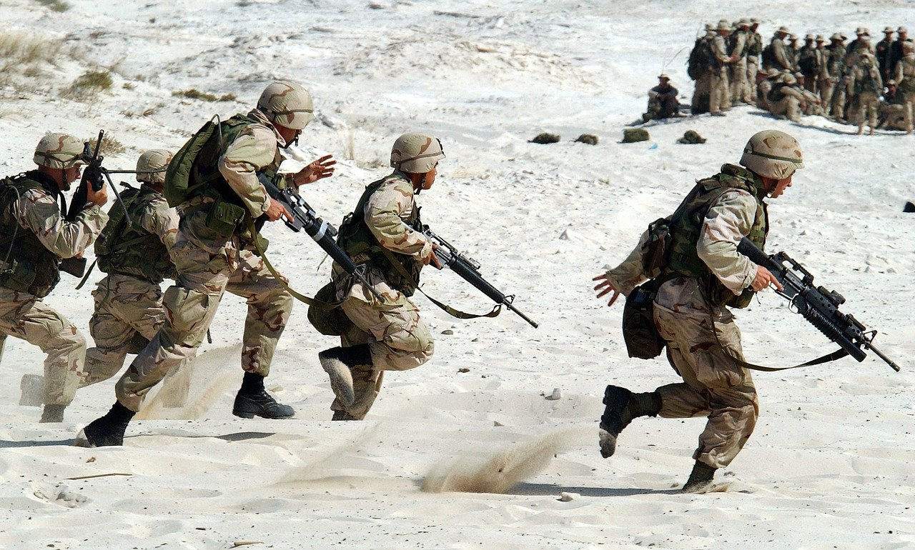 Soldiers running in sand