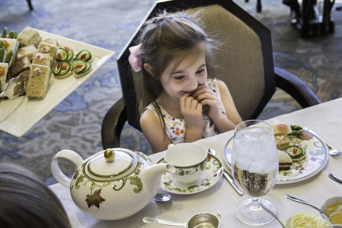 My youngest granddaughter loved the finger sandwiches at our afternoon tea at The Phoenician. Photo by Debby Wolvos